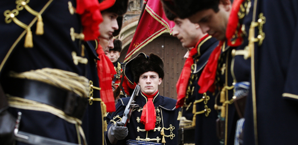 Soldiers in traditional military uniforms attend a guard exchanging ceremony at St. Mark's Square in Zagreb