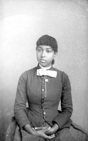 seated-with-bow-harper-alvan-s-photographed-in-tallahassee-florida-between-1885-and-1910