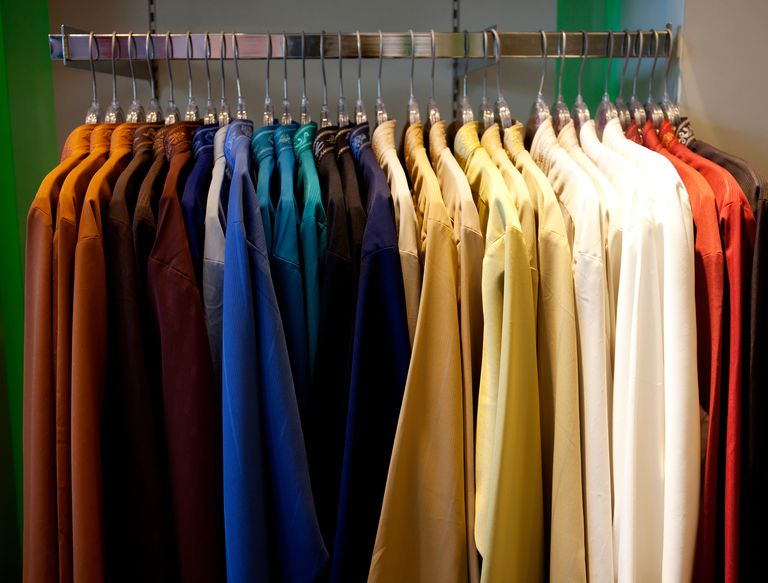 close-up-of-clothes-hanging-in-row-739240657-5a78b11f8e1b6e003715c0ec
